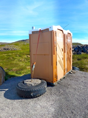 Cement filled tires secured to porta potties. An exceptionally windy area of Iceland.