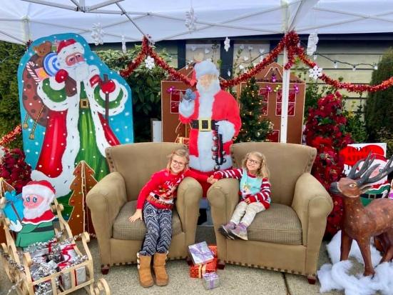 Giggles visiting with Cardboard Santa - new memories 2020